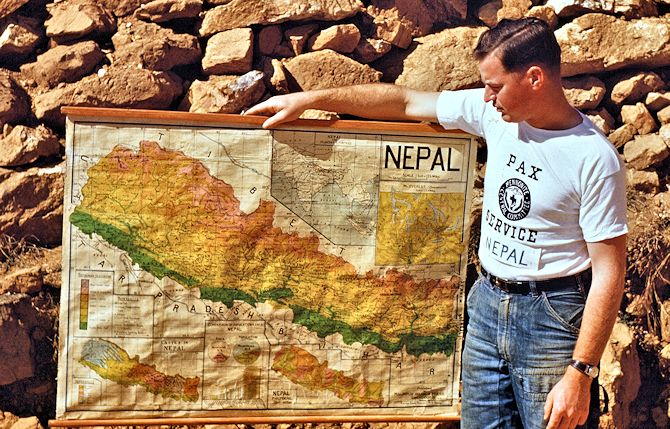 Otho Horst holding map of Nepal during his time in MCC Pax service after WWII